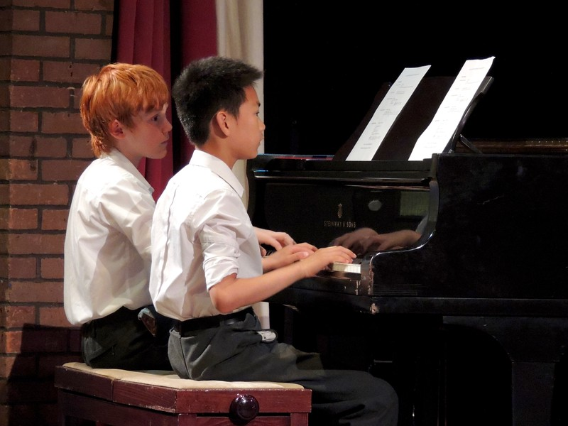 Abingdon pupils playing a piano duet