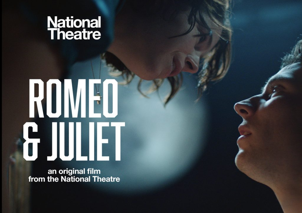 Juliet leans down to Romeo's face, with a full moon in the background