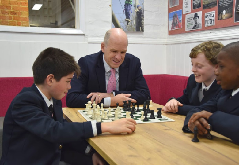 Abingdon School Headmaster playing chess with Lower School pupils
