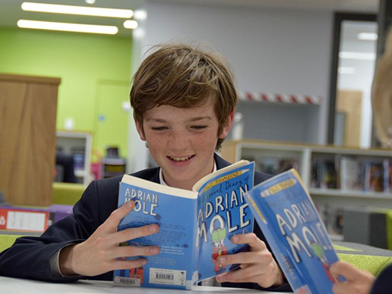 Abingdon School pupil in library