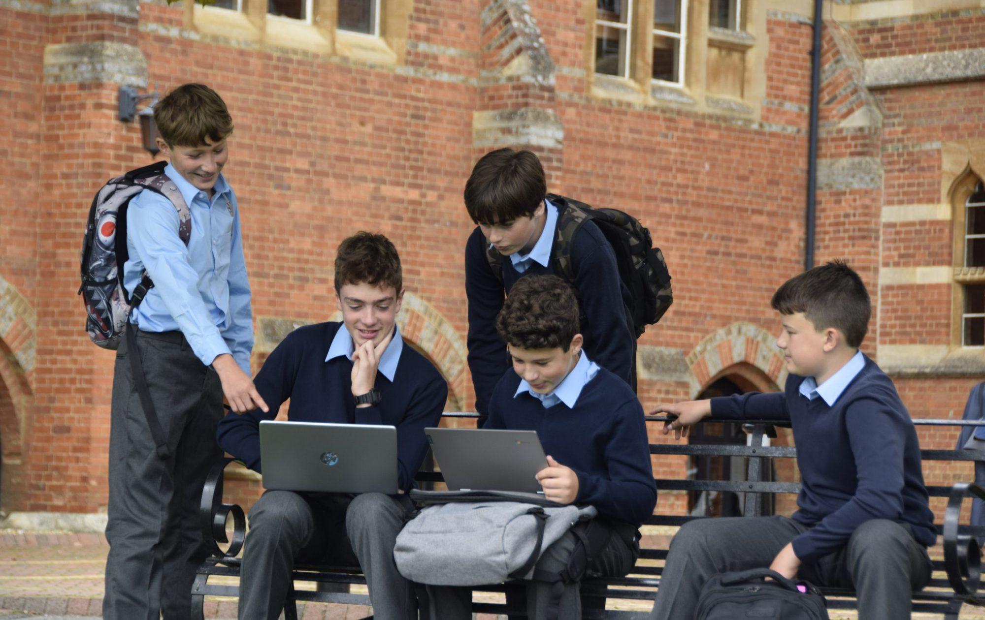 Abingdon School pupils laptops outside
